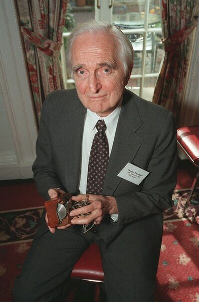 FILE - In this April 9, 1997 file photo, Doug Engelbart, inventor of the computer mouse and winner of the half-million dollar 1997 Lemelson-MIT prize, poses with the computer mouse he designed, in New York. Engelbart has died at the age of 88. The cause of death wasn't immediately known. (AP Photo/Michael Schmelling, File)