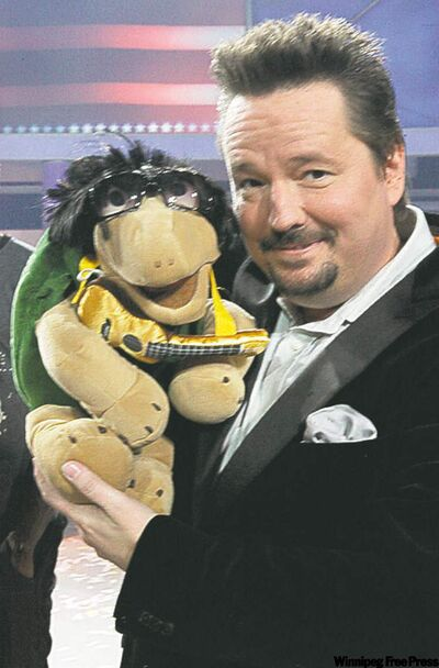 "Terry Fator  and his puppet after he was named the winner of NBC's ""America's Got Talent""."