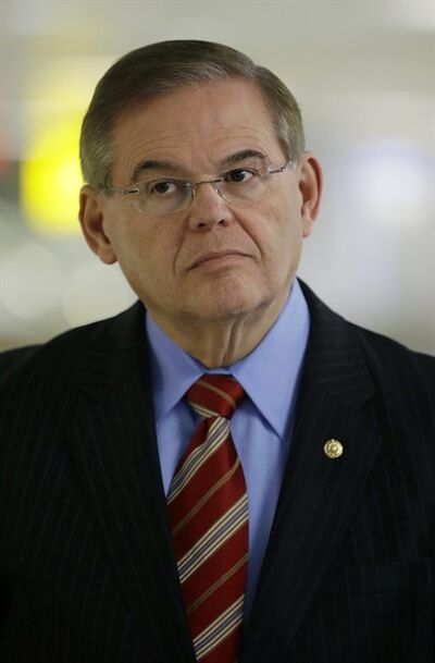 In this Friday, March 1, 2013 photograph, Sen. Robert Menendez, D-NJ, listens during a news conference at Newark Liberty International Airport in Newark, N.J. In the past, Sen. Robert Menendez sponsored legislation with incentives for natural gas vehicle conversions that would benefit the biggest political donor to his re-election, the same eye doctor whose private jet Menendez used for two personal trips to the Dominican Republic, an Associated Press investigation found. The disclosure reflects the latest intersection between Menendez, who is the subject of an ethics inquiry on Capitol Hill, and Florida doctor Dr. Salomon Melgen, who is involved in a federal criminal investigation. (AP Photo/Mel Evans)