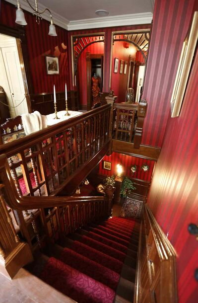 The view down the staircase from the second floor in the Dalnavert House Museum.