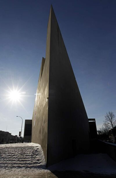 The sun rises behind the distinctive shape of the Winnipeg Art Gallery in February.