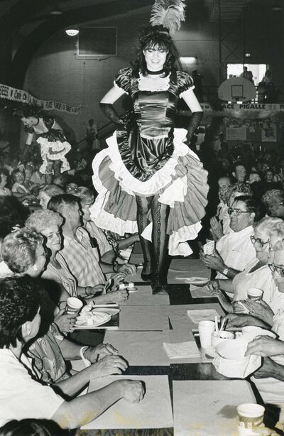 WAYNE GLOWACKI / WINNIPEG FREE PRESS FILES</p><p>Can-can dancers make a grand entrance at the France pavilion in 1987 by walking on table tops.</p>