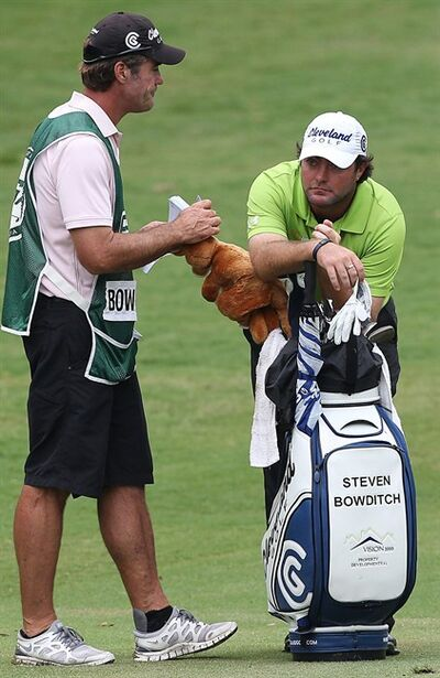 Co-leader Steven Bowditch of Australia, right, talks to his caddy, Greg McMilan, left, during the first round of the Australian PGA golf Championship held at the Hyatt Regency, Coolum, Australia, Thursday, Nov. 24, 2011. (AP Photo/Tertius Pickard)