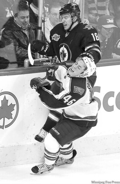 trevor hagan / winnipeg free press archivesJets� Bryan Little (18) and Minnesota Wild Jared Spurgeon (46) collide during the Jets� win Dec. 13. Little is in sick bay after taking a shot to the back Saturday.