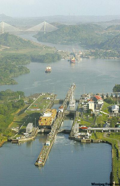 Ships sail through Miraflores Locks near Panama City.