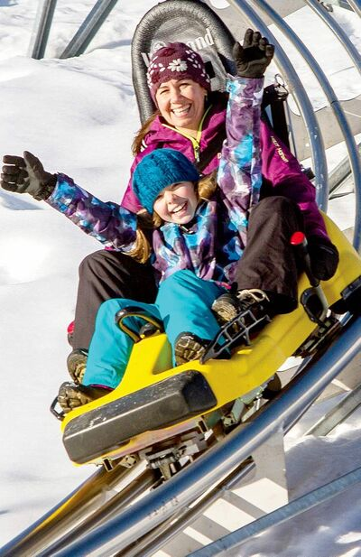 Riders control the speed on the Mountain Coaster at the Cranmore Mountain Resort in North Conway, N.H. They can zip along at up to 40 kilometres per hour.