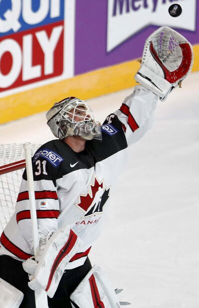 Petr David Josek / The Associated Press Files</p><p>Calvin Pickard reaches for the puck during a game against the Czech Republic at the men's world hockey championship earlier this month.</p>
