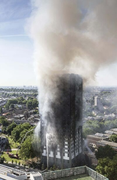 RICK FINDLER / THE ASSOCIATED PRESS FILES</p><p>Smoke billows after fire engulfed the 24-storey Grenfell Tower in west London on June 14.</p>