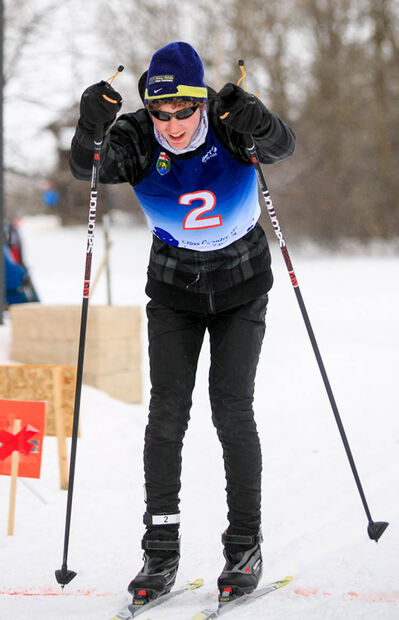 Jesse Bachinsky smiles as he crosses the finish line of the 7.5km male juvenile cross country ski race at the 2014 Manitoba Winter Games at Birch Ski Area in Roseisle, MB.