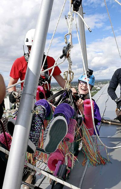 WAYNE GLOWACKI / WINNIPEG FREE PRESS Allie Onslow, 18, Team Unstoppable member gets prepared to to go over the ledge of the Manitoba Hydro Building, Tuesday.
