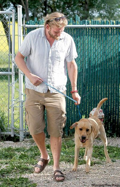 BORIS MINKEVICH / WINNIPEG FREE PRESS Geordie Ross with Miles, safely tethered to a leash.