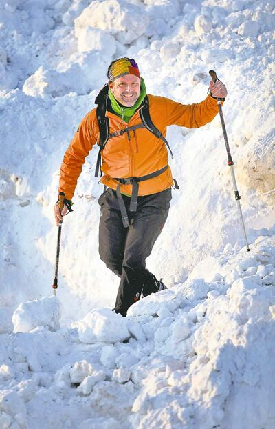 A mountain of snow is no match for experienced climber Dean Carriere.