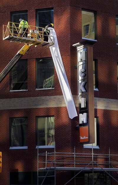 PHIL HOSSACK / WINNIPEG FREE PRESS</p><p>The former Crocus Building gets a new name Wednesday afternoon as workers unveil the new sign.</p>