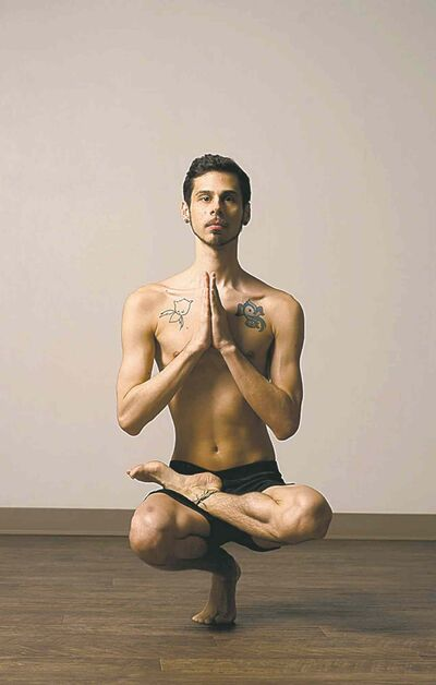 "Adrian Hummell, who teaches yoga, says men associate yoga ""with things like Pilates or aerobics, and they think of it as a chick workout.�  Illustrates YOGA-MEN (category l), by Eric Niiler, special to The Washington Post. Moved Tuesday, October 22, 2013. (MUST CREDIT: Washington Post photo by Marvin Joseph.)"