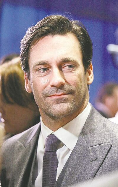 "FILE - Jon Hamm, of AMC's ""Mad Men"" television show, is interviewed on the New York Stock Exchange trading floor, in this March 21, 2012 file photo. The show is scheduled to premiere its new season Sunday. ""I've been around long enough to remember the Big Eight,"" the Missouri alum (Class of '93) told Associated Press television writer Lynn Elber. ""Then we're in the Big 12. And now we're in the SEC, which is really weird for me because this is our first season, and our football team just got destroyed.   (AP Photo/Richard Drew, File) ORG XMIT: NY107"