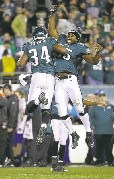 Philadelphia's Bryce Brown (left) and LeSean McCoy celebrate after an Eagles TD.