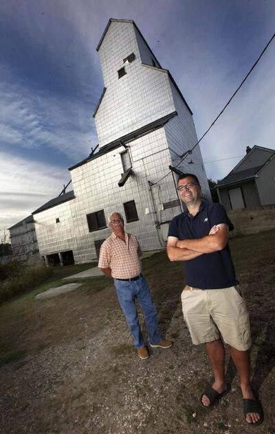 PHIL HOSSACK / WINNIPEG FREE PRESS</p><p>Matt Bialek (right) and his father Randy are lobbying to preserve the Tyndall grain elevator.</p></p>