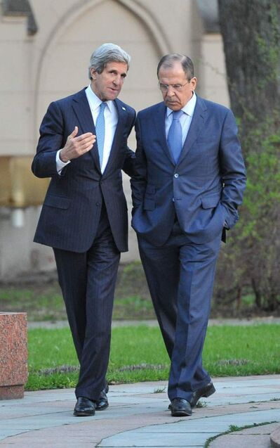 Russian Foreign Minister Sergey Lavrov, right, and U.S. Secretary of State John Kerry walk prior to their talks in the garden of the Foreign Ministry mansion in Moscow, Russia, Tuesday, May 7, 2013. Secretary of State John Kerry on Tuesday argued the U.S. case to Russian President Vladimir Putin for Russia to take a tougher stance on Syria at a time when Israel's weekend air strikes against the beleaguered Mideast nation have added an unpredictable factor to the talks.