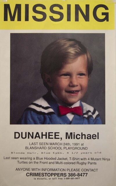 DARREN STONE / TIMES COLONIST</p><p>A poster for 4-year-old Michael Dunahee, who was abducted from a Victoria playground and never found.</p>