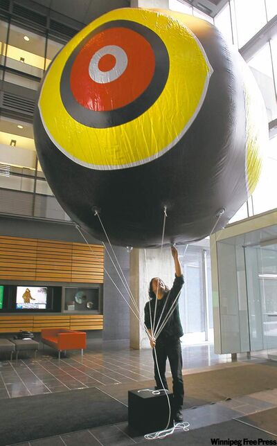 Raven Chacon installs Repellent Eye in Manitoba Hydro Place.
