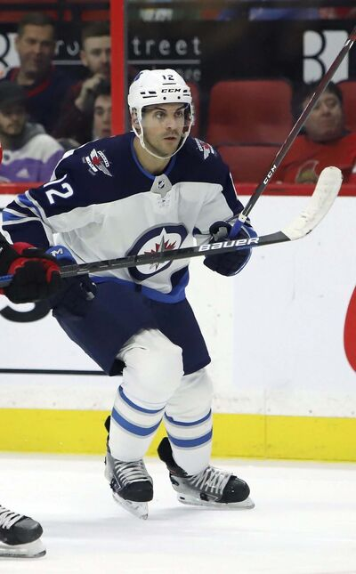 Fred Chartrand / The Canadian Press files</p><p>A groin strain on a routine play put and end to Jets defenceman Dylan DeMelo's playoffs early in the first game against the Montreal Canadiens. </p>