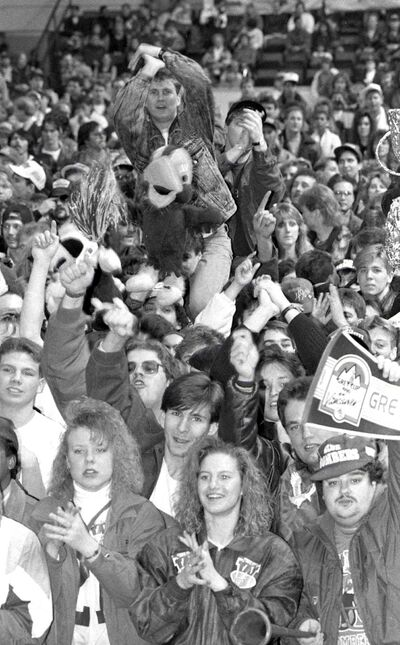 Fans at Winnipeg Blue Bomber Grey Cup rally at the Winnipeg Arena on November 26, 1990.