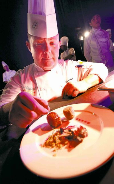 Timothy Palmer of The Velvet Glove puts the finishing touches to an appetizer dish.