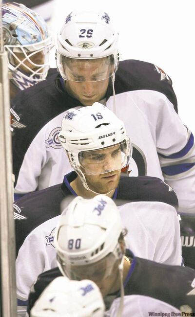 Blake Wheeler, Jim Slater and Nik Antropov (from top) are beaten men and look it after an embarrassing loss to the Coyotes in Phoenix Saturday night.