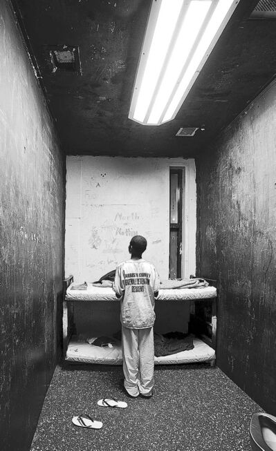 A 12-year-old boy in a cell at Harrison County Juvenile Detention Center in Biloxi, Miss.