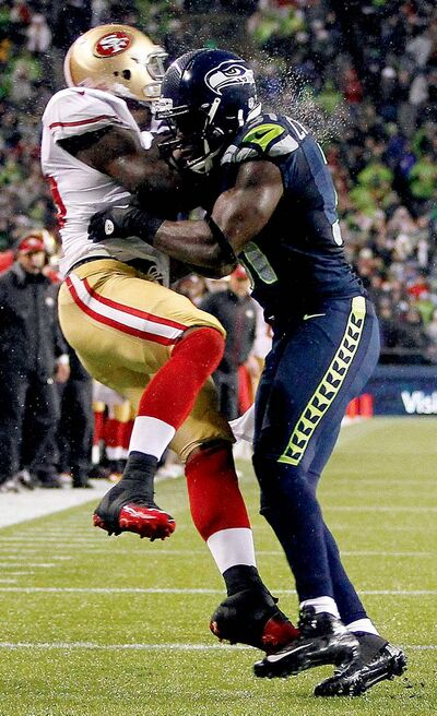 John Froschauer / the associated press archivesSan Francisco tight end Vernon Davis (left) tangles with Seattle safety Kam  Chancellor during NFL action last season.