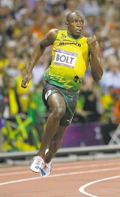 Bolt runs to win gold.