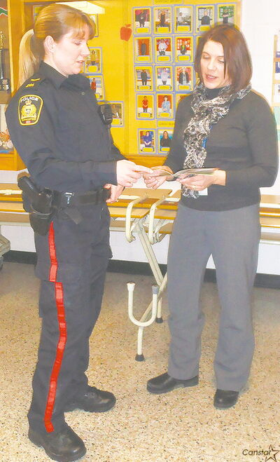 Ecole Robert Browning principal Michelle Clarke and Const. Lisa Allison of the Winnipeg Police Service discuss safety awareness.