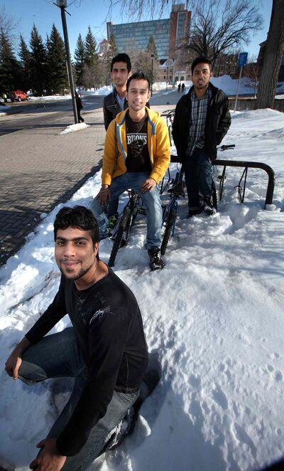 Shahrukh Altaf (front) and (from left) Saif Ali, Kabir Kang and Ehtisham Rauf at the U of M. The international students have survived their first winter here -- a brutal one -- and even had some fun.