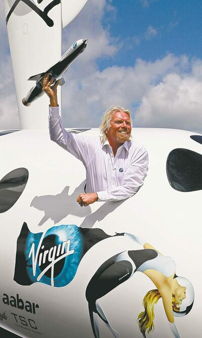 LEFTERIS PITARAKIS / THE ASSOCIATED PRESS ARCHIVESBritish billionaire Richard Branson leans out the window of a replica of the Virgin Galactic spaceship at England�s Farnborough air show in July.
