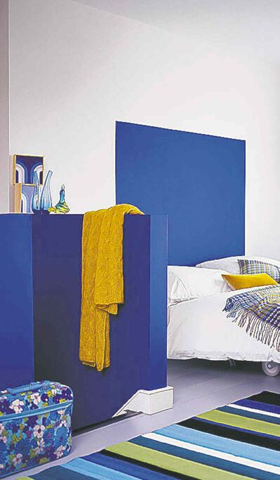 The most effective way to use splashes of colour are on focal points such as the head of the bed.