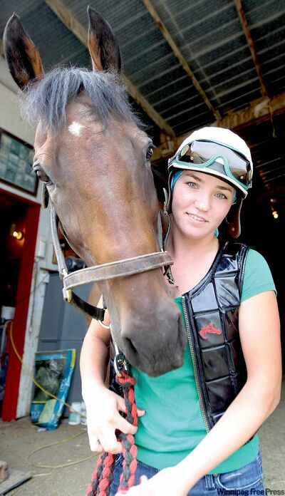 Horse whisperer and jockey Jennifer Reid with Moment of Song at Assiniboia Downs.