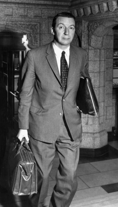 Former Bank of Canada Governor James E. Coyne arrives at the Senate entrance to the Parliament Buildings in Ottawa on July 12, 1961. James Elliott Coyne, a former Bank of Canada governor who battled over policy with prime minister John Diefenbaker, died Friday night in Winnipeg. He was 102.