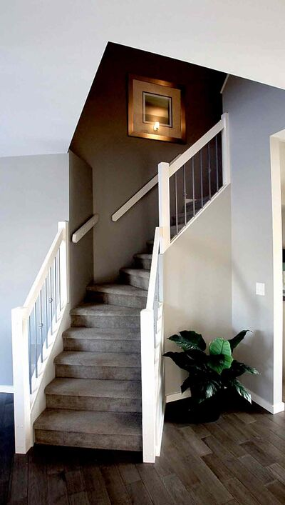 The angled design of the central staircase opens up space and gives the home a unique look.
