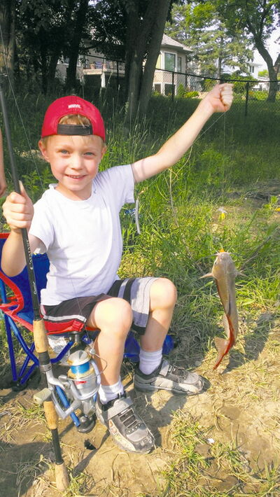 July 24 -- 5 year old Declan Pfeifer pulled his first catfish out of the Assiniboine at Westwood Green this July. No license required for kids under 16; Bug spray recommended!  SHARON PFEIFER/FOR CANSTAR NEWS METRO