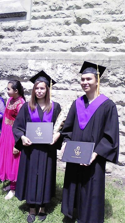 SUPPLIED</p><p>Stewart Andrews (right) and Angel Taylor graduated from high school in Winnipeg in 2018.</p>