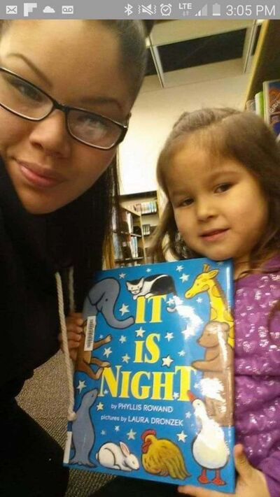 SUBMITTED PHOTO</p><p>Hailee Desjarlais, with mom Erin, and a book from the Dolly Parton Imagination Library. </p></p>