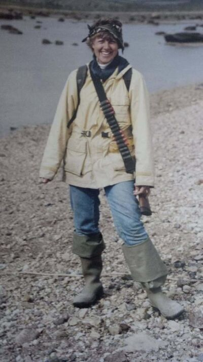 Petch in the famous Rambo picture with a bear gun and an ammo belt slung over her shoulder. (Supplied)