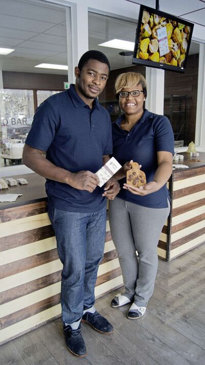 Christian and Christelle Mekoh recently opened their new chocolate shop, Aschenti Cocoa, at 782 Corydon Ave.