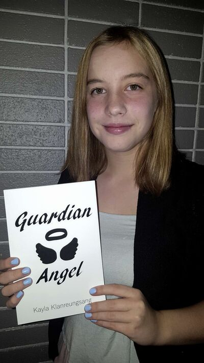 Kayla Klanreungsang, 14, with her first book Guardian Angel, which was published by Sigma's Bookshelf.