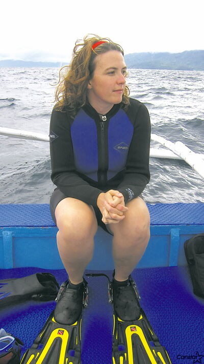 Mavis McRae, in reflective mood, on a previous diving expedition.