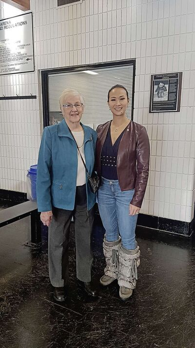 Coun. Vivian Santos and Edna Poulter, Charlie Gardiner's niece, in front of the new sign at the Charlie Gardiner Arena.