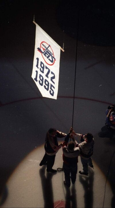A banner is raised to the Winnipeg Arena rafters at a 'funeral' for the Jets. Shortly afterward, the Business Council of Manitoba was formed with the goal of helping the province avoid such blows to its pride in the future.