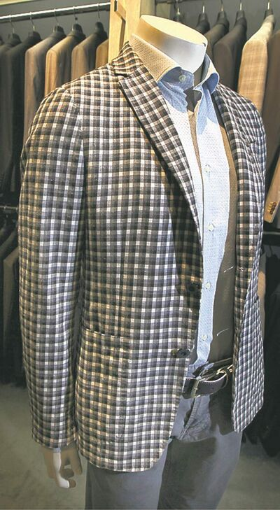 Suit at Vittorio Rossi Clothiers, see Kelly Taylor story, this is NOT the suit in the origiona assignment, he'll have the details. June 11, 2013 - (Phil Hossack / Winnipeg Free Press)