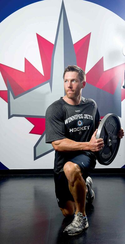 DAVID LIPNOWSKI / WINNIPEG FREE PRESS  Dr. Craig Slaunwhite works out in the Winnipeg Jets gym. He was hired earlier this month as the Winnipeg Jets director of fitness.