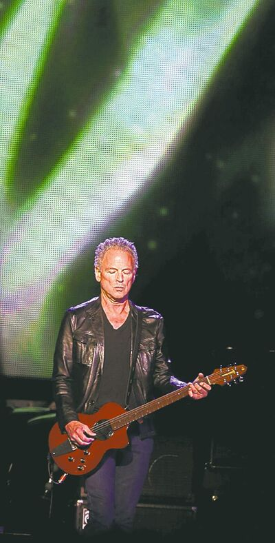 Lindsey Buckingham gets into the music.